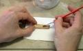 Consolidação de objecto de osso trabalhado